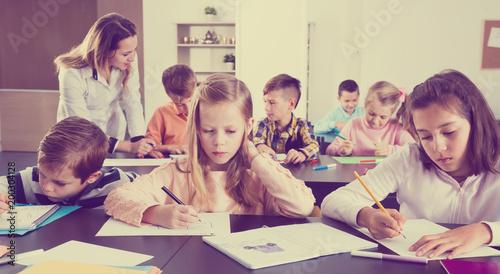 Foto Murales Little children with teacher in classroom