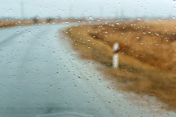 raindrops on car glass, wet asphalt, rain on glass, drive on highway in heavy rain