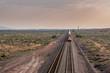 Straight on View of Train Rolling Aross Desert