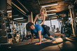Young couple having fun in fitness center.