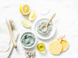 Leinwanddruck Bild - Homemade beauty facial mask. Clay, lemon, oil, facial brush - beauty products ingredients on light background, top view