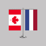 Table stand with flags of Canada and Netherlands.Two flag. Flag pole. Symbolizing the cooperation between the two countries. Table flags