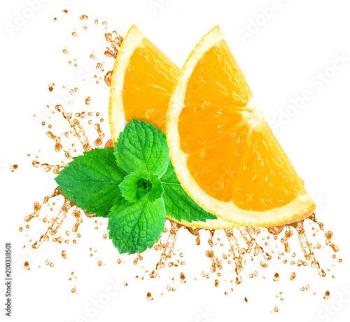 Fotobehang Sap orange juice splash and mint isolated on white