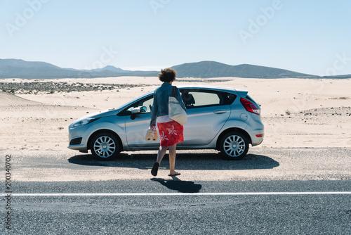 Deurstickers Canarische Eilanden Car parked on the road by the dunes