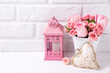 Pink roses flowers  in white pot, decorative heart and pink lantern