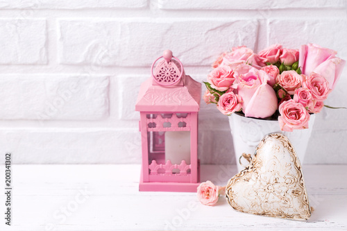 Wall mural Pink roses flowers  in white pot, decorative heart and pink lantern