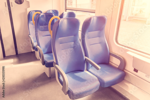 Salon of the speed commuter train with empty blue seats
