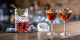 Manhattan cocktail drink decorated on bar counter in pub or restaurant