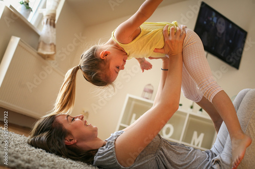 Single mother have play with her daughter.
