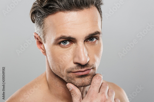 Handsome mature man. Looking camera.