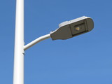 Modern LED street lamp post isolated on blue sky background
