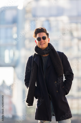 Foto Murales portrait of a wintry clothed young man