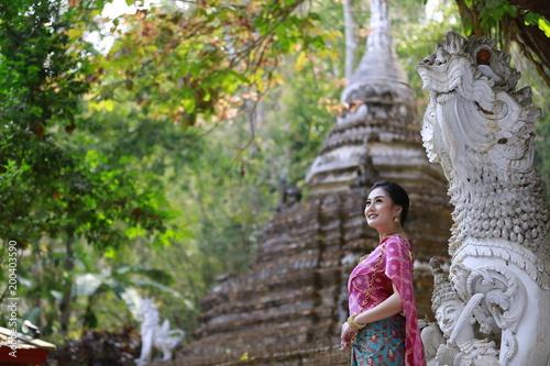 Fotobehang Boeddha An elegant Lanna woman Chiang Mai North Thailand.