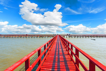 The red bridge and cloudy blue sky background. bridge cross the sea. Samutsakhon province Thailand.
