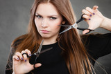 Professional elegant female barber with scissors. - 200413799