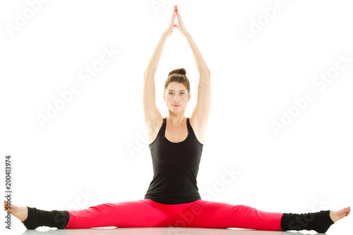 Foto Murales Fit girl stretching isolated on white.