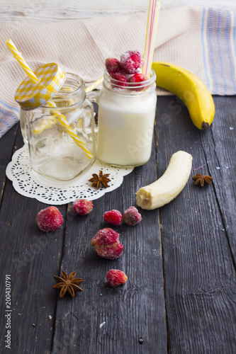 Fotobehang Milkshake milk shake in a jar on a wooden background