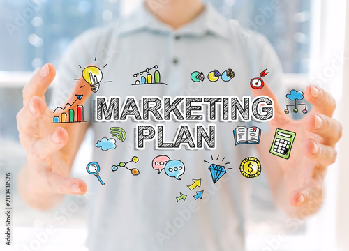 Marketing Plan with young man holding his hands