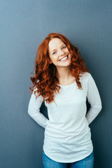 Happy friendly young woman with a lovely smile © contrastwerkstatt