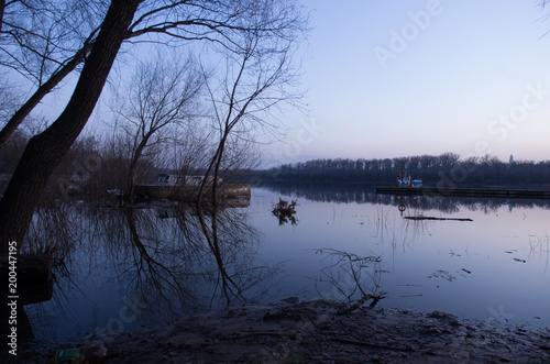 Foto op Plexiglas Kiev An old abandoned boat. Morning by the river.