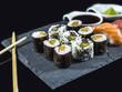 Sushi Set on Slate with Sushi Rolls and Wasabi on Black Background