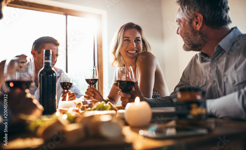 Friends having great time at dinner party