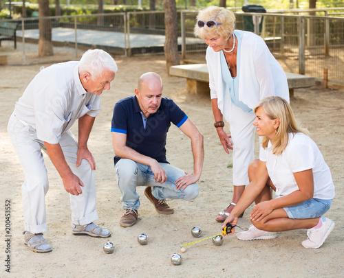 Mature people playing bocce