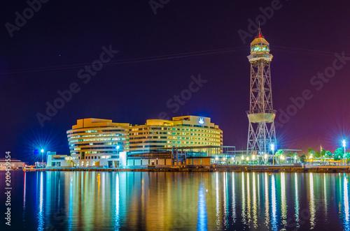 Fotobehang Barcelona Night view of the illuminated world trade center in Barcelona