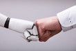 Robot And Human Hand Making Fist Bump