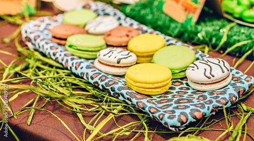 Fotobehang Macarons Macarons in candybar on a decorated tropical party.