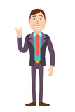 Businessman showing Rock and Roll sign - 200490370