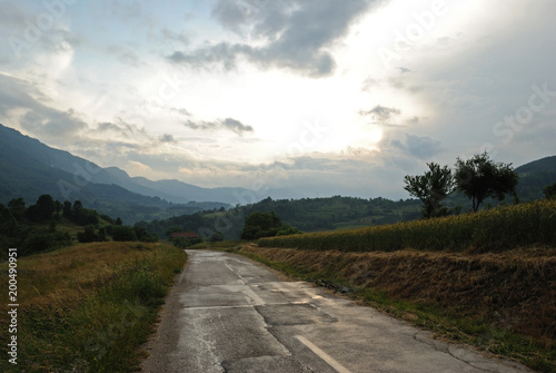 Foto op Canvas Wit Mountain landscape and road trough a countryside