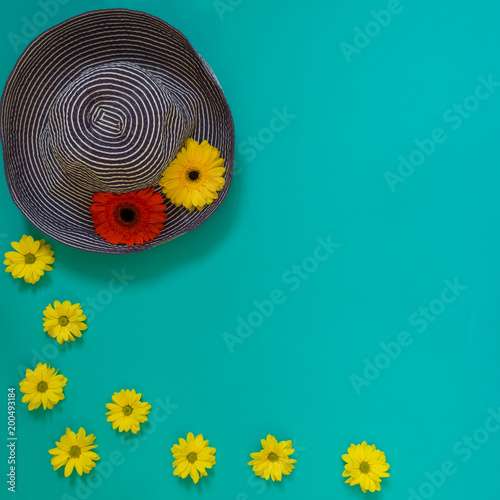 Fotobehang Pop Art Beach blue hat decorated with red and yellow flowers