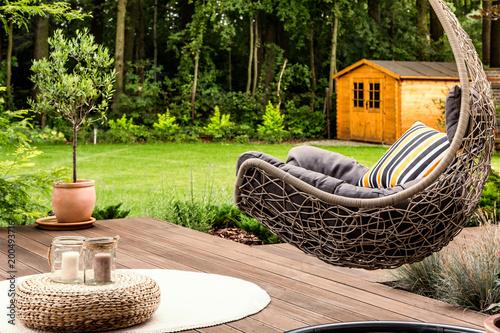 Foto Murales Hanging chair in the garden