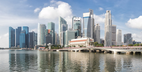 Singapore skyline in daytime.Panoramic view of Singapore business district.Modern buildings landscape with blue sky and reflection in water
