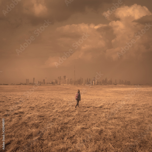 Single girl at vastness as loneliness and freedom concept