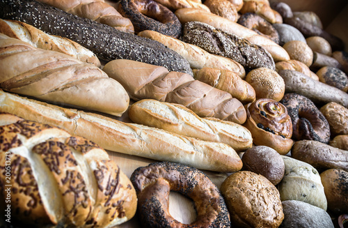 freshly baked bread and bakery products on the counter. background of different types of bread, bread rolls and products