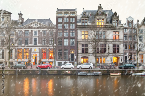 Foto op Aluminium Amsterdam Cityscape - winter view of the houses with festive decorations and the city channel with boats, city of Amsterdam, The Netherlands