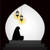 Muslim woman reading Quran on sunset background - 200520177