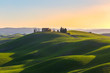 Tuscany, Italy. Spring landscape with rolling hills and green meadow.