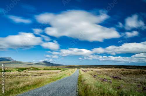 Foto op Aluminium Blauw Road immersed in the peat bogs that together with the celo characterize the Irish landscape Donegal Ireland