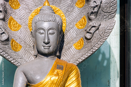 Aluminium Boeddha Close-up buddha in the temple in the morning.