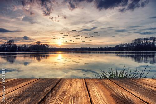 Leinwanddruck Bild Stille am See - Steg Bei Sonnenuntergang