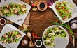 A set of salads. Lettuce, salmon, veal. Top view. On a wooden background. Copy space. - 200541338