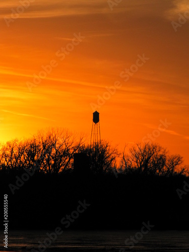 Foto op Plexiglas Oranje eclat Water Tower at Sunset