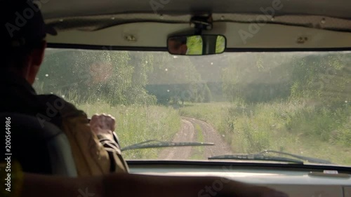 Driving old jeep on mountain road in Kazakhstan