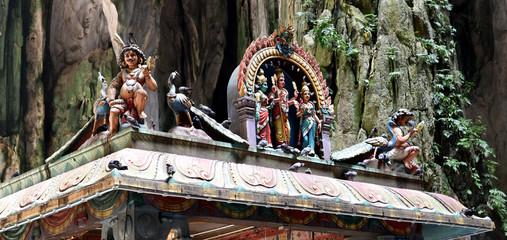 Hindu shrines with colorful figures - detail of temple inside the Batu Caves - Kuala Lumpur, Malaysia