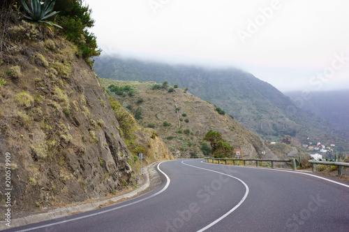 Plexiglas Canarische Eilanden A winding road to the mountains, Canary Islands