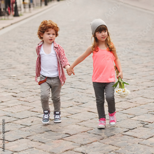 boy and girl walking on the street