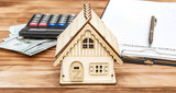 Property assessment form with money, calculator and model of house on the table. Property valuation concept. - 200616796